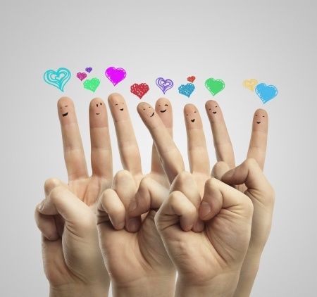 11788946 - group of happy finger smileys with love heart speech bubbles and social chat sign.